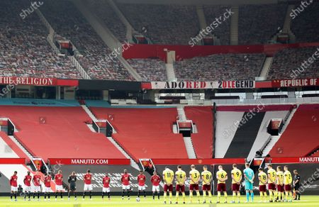 Players of Manchester United (L) and Burnley (R) observe a minute of silence in memory of late Prince Philip, Duke of Edinburgh and husband of Queen Elizabeth II, prior to the English Premier League soccer match between Manchester United and Burnley FC at Old Trafford in Manchester, Britain, 18 April 2021.