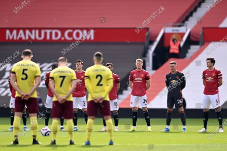 Stock Picture of Players of Manchester United (back) and Burnley (L) observe a minute of silence in memory of late Prince Philip, Duke of Edinburgh and husband of Queen Elizabeth II, prior to the English Premier League soccer match between Manchester United and Burnley FC in Manchester, Britain, 18 April 2021.