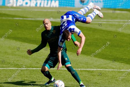Alaves' defender Alberto Rodriguez 'Tachi' (R) vies for the ball with Huesca's striker Sandro Ramirez (L) during the LaLiga soccer match between Deportivo Alaves and SD Huesca held at Mendizorrotza stadium in Vitoria, Basque Country, Spain, 18 April 2021.