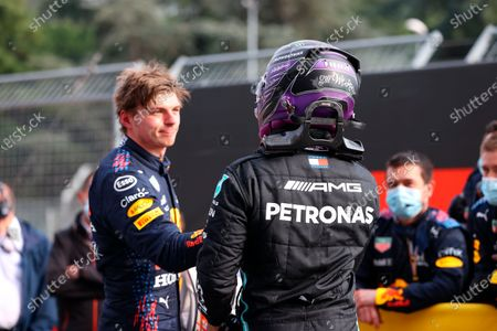 Third placed McLaren's Lando Norris, left, greets second placed Mercedes Lewis Hamilton at the end of the Emilia Romagna Formula One Grand Prix, at the Imola racetrack, Italy