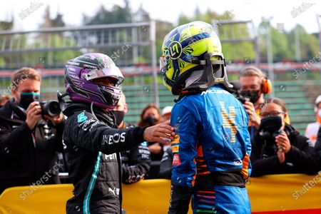 Third placed McLaren's Lando Norris, right, is greeted by second placed Mercedes' Lewis Hamilton at the end of the Emilia Romagna Formula One Grand Prix, at the Imola racetrack, Italy