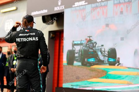 Second placed Mercedes Lewis Hamilton waits for the start of the podium ceremony at the end of the Emilia Romagna Formula One Grand Prix, at the Imola racetrack, Italy