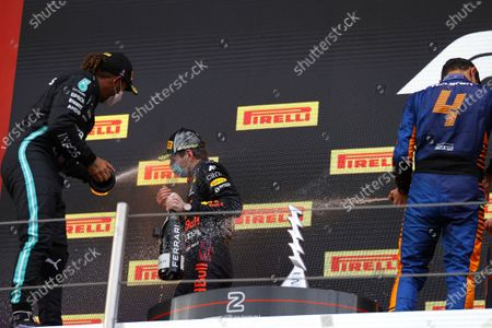 From left, second placed Mercedes Lewis Hamilton, first placed Red Bull's Max Verstappen and third placed McLaren's Lando Norris celebrate on the podium at the end of the Emilia Romagna Formula One Grand Prix, at the Imola racetrack, Italy