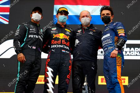 Stock Picture of From left, second placed Mercedes Lewis Hamilton, first placed Red Bull's Max Verstappen, Ron Dennis and third placed McLaren's Lando Norris celebrate on the podium at the end of the Emilia Romagna Formula One Grand Prix, at the Imola racetrack, Italy