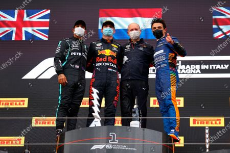 From left, second placed Mercedes Lewis Hamilton, first placed Red Bull's Max Verstappen, Ron Dennis and third placed McLaren's Lando Norris celebrate on the podium at the end of the Emilia Romagna Formula One Grand Prix, at the Imola racetrack, Italy