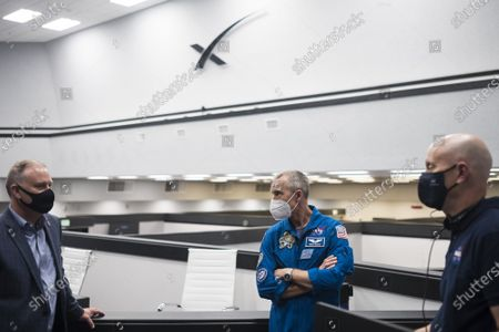 Norm Knight, deputy director of Flight Operations at NASA's Johnson Space Center, left, Andrew Feustel, deputy chief of the Astronaut Office, center, Stephen Koerner, director of the Flight Operations Directorate at NASA's Johnson Space Center, right, are seen during a dress rehearsal in preparation for the launch of a SpaceX Falcon 9 rocket carrying the company's Crew Dragon spacecraft on NASA's SpaceX Crew-2 mission with NASA astronauts Shane Kimbrough and Megan McArthur, ESA (European Space Agency) astronaut Thomas Pesquet, and Japan Aerospace Exploration Agency (JAXA) astronaut Akihiko Hoshide onboard, on Sunday, April 18, 2021, in firing room four of the Launch Control Center at NASA's Kennedy Space Center in Florida. NASA's SpaceX Crew-2 mission is the second operational mission of the SpaceX Crew Dragon spacecraft and Falcon 9 rocket to the International Space Station as part of the agency's Commercial Crew Program. Kimbrough, McArthur, Pesquet, and Hoshide are scheduled to launch at 6:11 a.m. ET on Thursday, April 22, from Launch Complex 39A at the Kennedy Space Center. NASA Photo by Joel Kowsky/UPI