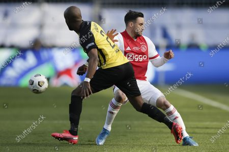 Vitesse's Eli Dasa, left, and Ajax's Nicolas Tagliafico, right, vie for the ball during the TOTO KNVB Cup final soccer match between Ajax and Vitesse at De Kuip stadium in Rotterdam, Netherlands