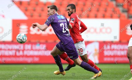 Beerschot's Yan Vorogovskiy and Standard's Mehdi Carcela fight for the ball during a soccer match between Standard Liege and Beerschot VA, Sunday 18 April 2021 in Liege, on day 34, the last day of the regular competition of the 'Jupiler Pro League' first division of the Belgian championship.