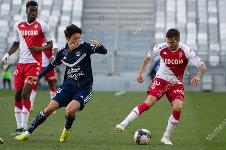 Stock Image of Monaco player Stevan Jovetic (R) in action against Girondins Bordeaux player Ui Jo Hwang (C) during the French Ligue 1 soccer match Bordeaux vs Monaco at Matmut stadium in Bordeaux, France, 18 April 2021.