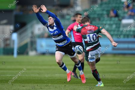 Ben Spencer of Bath Rugby looks to charge down a George Ford of Leicester Tigers clearance