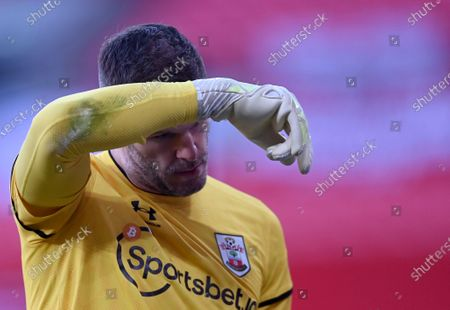 Southampton's goalkeeper Fraser Forster reacts during the English FA Cup semifinal soccer match between Leicester City and Southampton at Wembley Stadium in London