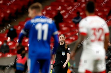 Referee assistant Sian Massey-Ellis, center, looks out during the English FA Cup semifinal soccer match between Leicester City and Southampton at Wembley Stadium in London