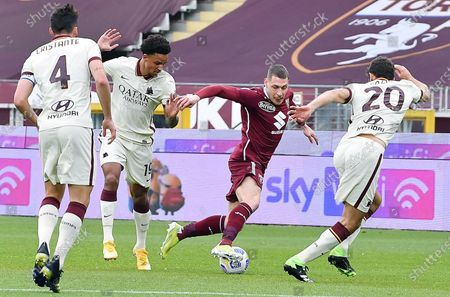 Stock Photo of Torino's Andrea Belotti (2-R) and Roma's Federico Fazio (R) in action during the Italian Serie A soccer match between Torino FC and AS Roma at the Olimpico Grande Torino Stadium in Turin, Italy, 18 April 2021.