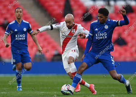 Southampton's Nathan Redmond (C) in action against Leicester's Wesley Fofana (R) during the English FA Cup semi final soccer match between Leicester City and Southampton FC in London, Britain, 18 April 2021.