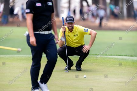 Webb Simpson lines up his putt on the first green during the final round of the RBC Heritage golf tournament in Hilton Head Island, S.C