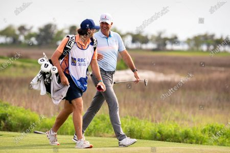 Reagan Cink, left, and his father Stewart Cink walk up the 18th fairway to the green during the final round of the RBC Heritage golf tournament in Hilton Head Island, S.C