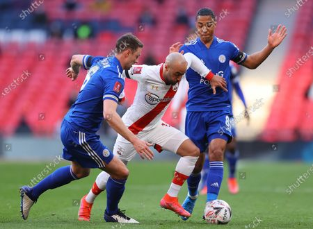 Southampton's Nathan Redmond (C) in action against Leicester players Jonny Evans (L) and Youri Tielemans (R) during the English FA Cup semi final soccer match between Leicester City and Southampton FC in London, Britain, 18 April 2021.