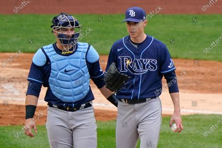 Tampa Bay Rays catcher Mike Zunino, left, walks on the mound with relief pitcher Ryan Yarbrough before manager Kevin Cash replaced Yarbrough during the seventh inning of a baseball game against the New York Yankees, at Yankee Stadium in New York