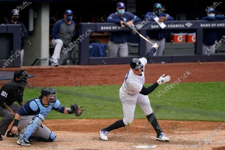 New York Yankees' Aaron Judge, right, strikes out on a pitch from Tampa Bay Rays relief pitcher Ryan Yarbrough during the fifth inning of a baseball game, at Yankee Stadium in New York. Rays catcher Mike Zunino, second from left, and home plate umpire Erich Bacchus, left, are behind the plate