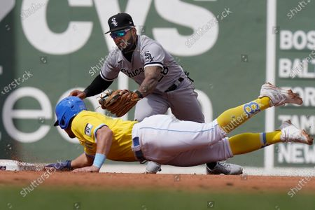 Chicago White Sox's Leury Garcia, right, reaches to Boston Red Sox's Hunter Renfroe, left, as Renfroe is picked off and caught stealing second in the fourth inning of a baseball game, in Boston