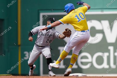 Chicago White Sox's Leury Garcia, left, reaches to Boston Red Sox's Hunter Renfroe, right, as Renfroe is caught stealing second in the fourth inning of a baseball game, in Boston