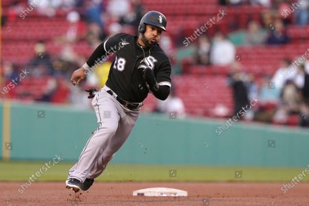 Chicago White Sox's Leury Garcia advances to third base on a double hit by Andrew Vaughn in the sixth inning of a baseball game against the Boston Red Sox, in Boston. The game is the second of a doubleheader Sunday