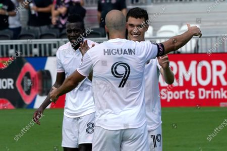 Inter Miami forward Robbie Robinson, right, celebrates with forward Gonzalo Higuain (9) after scoring a goal during the first half of an MLS soccer match against LA Galaxy, in Fort Lauderdale, Fla