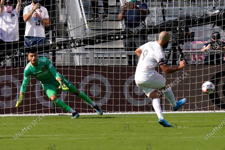 Inter Miami forward Gonzalo Higuain (9) scores a goal on penalty kick past LA Galaxy goalkeeper Jonathan Bond during the second half of an MLS soccer match, in Fort Lauderdale, Fla