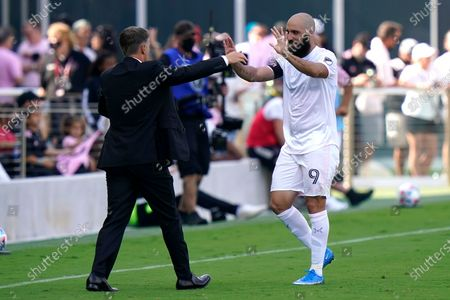 Inter Miami forward Gonzalo Higuain (9) celebrates with head coach Phil Neville after scoring a goal on a penalty kick during the second half of an MLS soccer match against LA Galaxy, in Fort Lauderdale, Fla