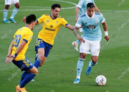 Cadiz's striker Ruben Sobrino (C) vies for the ball with Celta Vigo's defender Jeison Murillo (R) during the Spanish LaLiga soccer match between Cadiz CF and Celta Vigo held at Ramon de Carranza stadium in Cadiz, southern Spain, 18 April 2021.