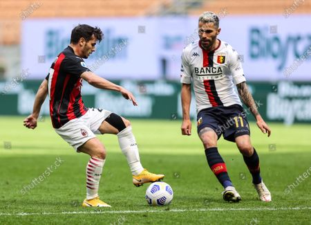 Brahim Diaz of AC Milan and Valon Behrami of Genoa CFC in action during the 2020/21 Italian Serie A football match between AC Milan and Genoa CFC at the Giuseppe Meazza Stadium. Final score; AC Milan 2:1 Genoa CFC.