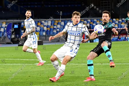 Napoli's Mario Rui (R) and Inter's Nicolo Barella (C) in action during the Italian Serie A soccer match between SSC Napoli and Inter Milan at Diego Armando Maradona stadium in Naples, Italy, 18 April 2021.