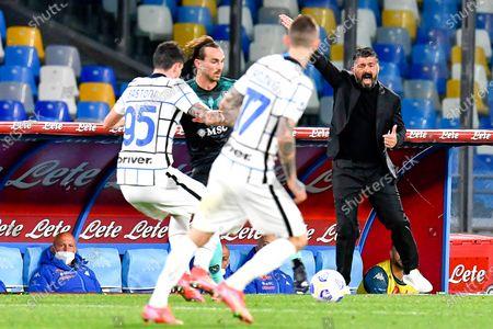 Napoli's head coach Gennaro Gattuso (R) reacts during the Italian Serie A soccer match between SSC Napoli and Inter Milan at Diego Armando Maradona stadium in Naples, Italy, 18 April 2021.