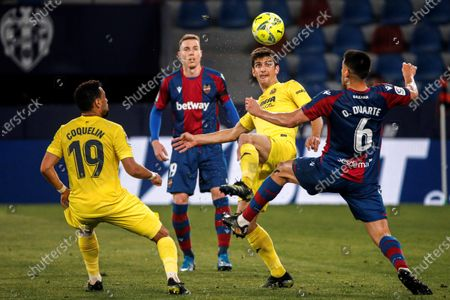 Villarreal's striker Gerard Moreno (2-R) vies for the ball with Levante's defender Oscar Duarte (R) during the Spanish LaLiga soccer match between Villarreal CF and Levante UD held at Ciutat de Valencia stadium, in Valencia, eastern Spain, 18 April 2021.