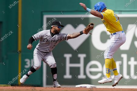 Chicago White Sox's Leury Garcia, left, reaches to Boston Red Sox's Hunter Renfroe, right, as Renfroe is picked off and caught steeling second in the fourth inning of a baseball game, in Boston