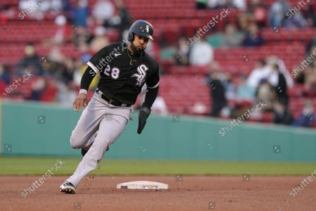 Chicago White Sox's Leury Garcia advances to third base on a double hit by Andrew Vaughn in the sixth inning of a baseball game against the Boston Red Sox, in Boston. The White Sox won 5-1. The game is the second of a doubleheader Sunday