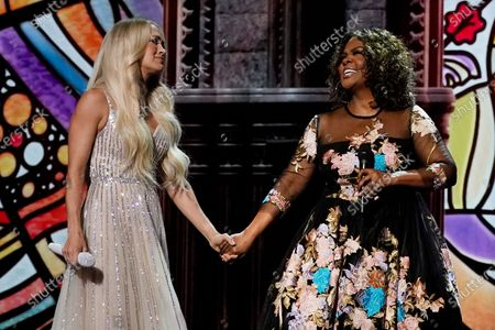 Carrie Underwood, left, and CeCe Winans perform at the 56th annual Academy of Country Music Awards, at the Grand Ole Opry in Nashville, Tenn. The awards show airs on April 18 with both live and prerecorded segments