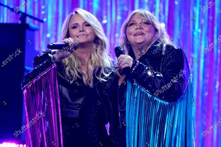 Miranda Lambert, left, and Elle King perform at the 56th annual Academy of Country Music Awards, at the Grand Ole Opry in Nashville, Tenn. The awards show airs on April 18 with both live and prerecorded segments