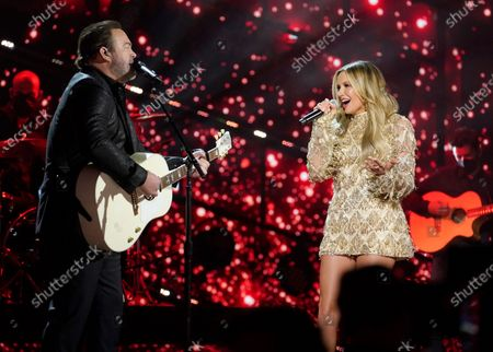 Lee Brice, left, and Carly Pearce perform at the 56th annual Academy of Country Music Awards, at the Grand Ole Opry in Nashville, Tenn