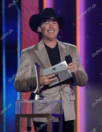 Clay Walker presents the award for album of the year at the 56th annual Academy of Country Music Awards, at the Grand Ole Opry in Nashville, Tenn