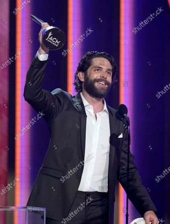 Thomas Rhett accepts the award for male artist of the year at the 56th annual Academy of Country Music Awards, at the Grand Ole Opry in Nashville, Tenn
