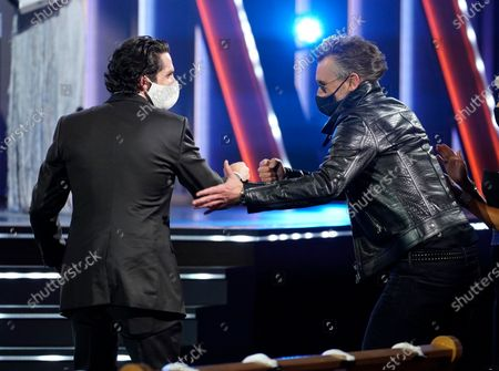 Eric Church, right, congratulates Thomas Rhett, winner of the award for male artist of the year at the 56th annual Academy of Country Music Awards, at the Grand Ole Opry in Nashville, Tenn