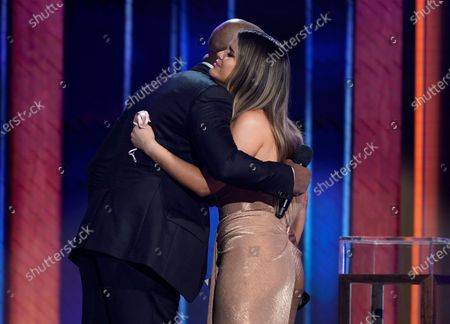 Darius Rucker, left, hugs Maren Morris as he presents her with the award for song of the year at the 56th annual Academy of Country Music Awards, at the Grand Ole Opry in Nashville, Tenn