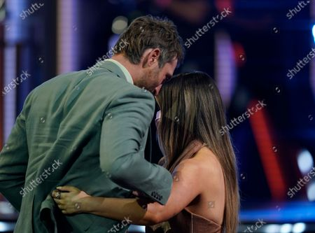 """Ryan Hurd, left, congratulates Maren Morris as he escorts her to the stage to accept the award for song of the year for """"The Bones"""" at the 56th annual Academy of Country Music Awards, at the Grand Ole Opry in Nashville, Tenn"""