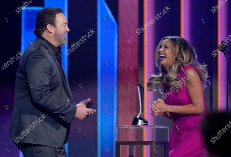 """Lee Brice, left, and Carly Pearce accept the award for single of the year for """"I Hope You're Happy Now"""" at the 56th annual Academy of Country Music Awards, at the Grand Ole Opry in Nashville, Tenn"""