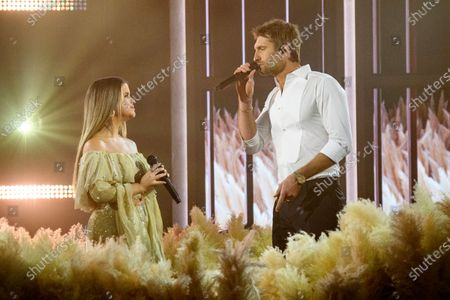Maren Morris, left, and Ryan Hurd perform at the 56th annual Academy of Country Music Awards on at the Ryman Auditorium in Nashville, Tenn. The awards show airs on April 18 with both live and prerecorded segments