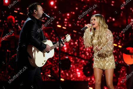 Stock Photo of Lee Brice, left, and Carly Pearce perform at the 56th annual Academy of Country Music Awards, at the Grand Ole Opry in Nashville, Tenn