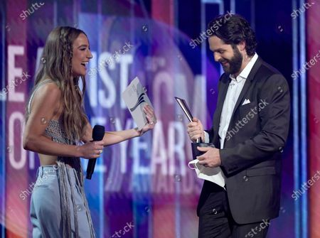 Ingrid Andress, left, presents the award for male artist of the year to Thomas Rhett at the 56th annual Academy of Country Music Awards, at the Grand Ole Opry in Nashville, Te nn