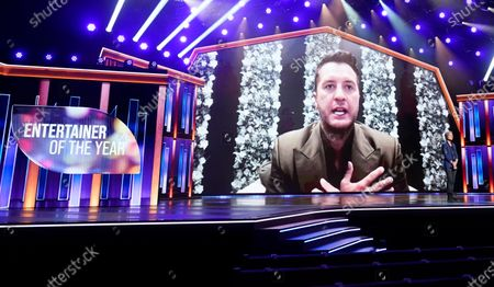 Luke Bryan appears on screen accepting the award for entertainer of the year at the 56th annual Academy of Country Music Awards, at the Grand Ole Opry in Nashville, Tenn