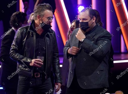 Eric Church, left, and Luke Combs appear at the 56th annual Academy of Country Music Awards, at the Grand Ole Opry in Nashville, Tenn